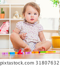 Happy toddler girl playing with her toys 31807632