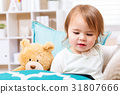Happy toddler girl watching her tablet computer 31807666