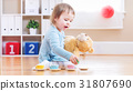 Toddler girl have tea with her teddy bear 31807690