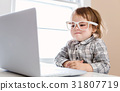 Little toddler girl using her laptop 31807719