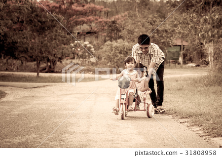 Child little girl having fun to ride tricycle 31808958