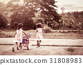 Child two girls having fun to pull her tricycle 31808983