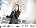 Young Asian businesswoman talking on cellphone 31810049