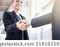 Businesswoman making handshake 31810150