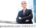 Asian businesswoman standing and crossing her arms 31810157