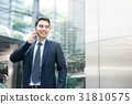 Asian businessman talking on mobilephone 31810575