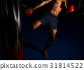 boxer kick at the target on boxing ring in gym 31814522