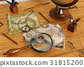 Vintage maps and magnifying glass on wood table 31815200