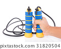 Hand holding blue and yellow skipping rope  31820504
