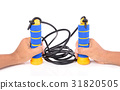 Hand holding blue and yellow skipping rope 31820505