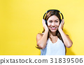 Happy young woman with headphones 31839506