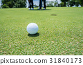 golf ball on putting green 31840173