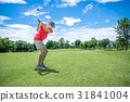 golfer playing golf with golf club on fairway 31841004