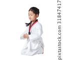 Happy Asian little girl is sitting on in taekwond 31847417