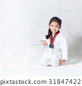 Happy Asian little girl smile sitting and tie a w 31847422
