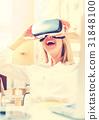 Young woman using virtual reality headset 31848100
