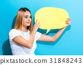 Young woman holding a speech bubble 31848243