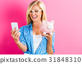 Young woman with a piggy bank 31848310