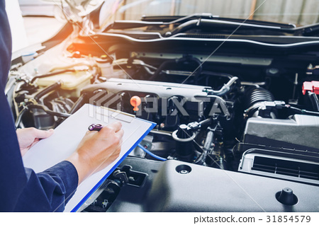 mechanic holding a clipboard of service  31854579