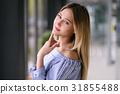 Beautiful blonde girl posing portrait indoors 31855488
