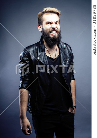 portrait of young bearded hipster guy smiling on 31859788