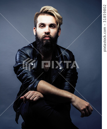 portrait of young bearded hipster guy smiling on 31859802
