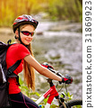 Woman traveling bicycle summer park. Early morning 31869923