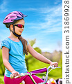 Child traveling bicycle in summer park. 31869928