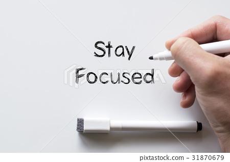 Stay focused written on whiteboard 31870679