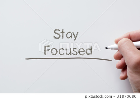 Stay focused written on whiteboard 31870680