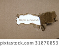 The word refer a friend  behind torn paper. 31870853