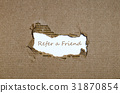 The word refer a friend  behind torn paper. 31870854