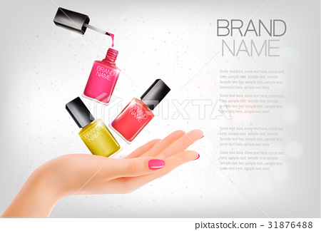 Manicured hands and several nail laquer bottles. 31876488