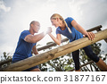 People jumping over the hurdles during obstacle course 31877167