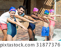 Male instructor and children preparing for jumping in swimming pool 31877376