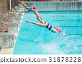 Children diving in water at poolside 31878228
