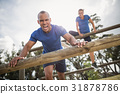 People jumping over the hurdles during obstacle course 31878786