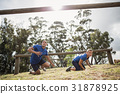 People passing through hurdles during obstacle course 31878925