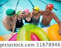 Happy senior swimmers enjoying in pool 31878946