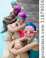 Little swimmers sitting at poolside 31879056