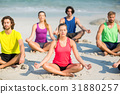Friends meditating in lotus position on shore 31880257