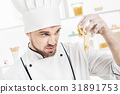 Chef in uniform makes dough in kitchen. Bad dough 31891753