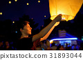 Teen boy with paper flying lanterns 31893044
