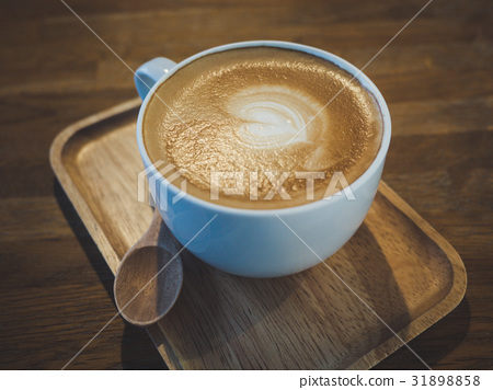 Latte coffee on wooden tray 31898858