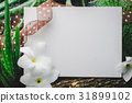 Blank frame with flowers on natural green leaves  31899102