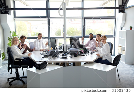 business team waving hands at office 31905439