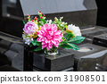 Grave and flowers 31908501