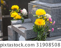 Grave and flowers 31908508