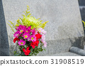 Grave and flowers 31908519