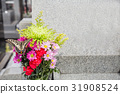 Grave and flowers 31908524